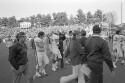 Preview image of Players and coaches leaving the field after University of Virginia versus University of Maryland football game