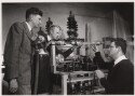 Preview image of Aeronautics with mathematics professor Thomas W. Williams and students performing an experiment