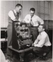 Preview image of Graduate engineering instructor Robert A. Gardiner, left, demonstrates the mechanism of a rosette strain computer to graduate students