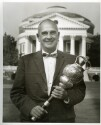 Preview image of Dean B.F.D. Runk holding the UVa mace
