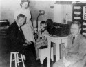Preview image of Dr. G. Slaughter Fitz-Hugh and Hope McFarland examine children of the Virginia School for the Deaf and Blind