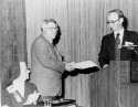 Preview image of John F. Harlan (second from left) receiving a certificate in Washington, D.C.