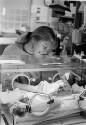 Preview image of Woman holding premature baby in the Neonatal Intensive Care Unit (NICU)