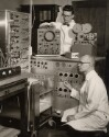 Preview image of Dr. Eugene D. Brand and Harry S. Marshall, the Grass Polygraph (left), and the dual beam oscilloscope and camera (right)