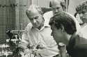 Preview image of Dr. Ernst Attinger with students in biomedical engineering lab