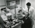 Preview image of Donald F. Hunt and Dr. Craig L. Slingluff use the tandem mass spectrometer