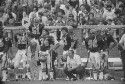 Preview image of Players and coaches on sideline at University of Virginia versus North Carolina State University football game