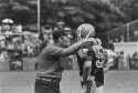 Preview image of Coach and player at University of Virginia versus Navy football game