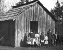Preview image of Students before their school buildings. From a print, A common type of rural school.