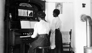House of William Kelton. Showing organ.