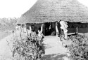 Preview image of Unidentified man in front of a hut/house.