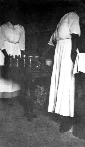 Sallie Marable canning in her house.