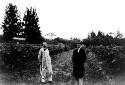 Preview image of Two unidentified men standing in a vineyard.