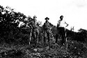 Preview image of Three unidentified men with walking sticks.